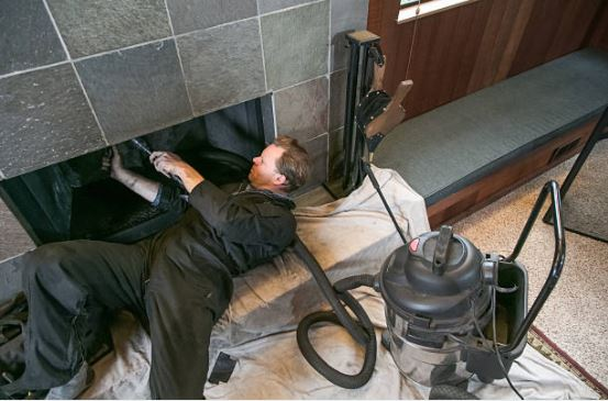 chimney sweep lying down cleaning